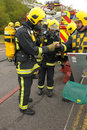 Firefighter in breathing gear Stock Images