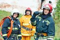 Firefighter crew in uniform in front of fire engine machine and fireman team Royalty Free Stock Photos