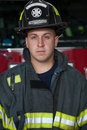 Firefighter Portrait In Front of Fire Truck Stock Image