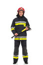 Firefighter posing with axe. Front view. Royalty Free Stock Photo
