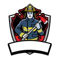 Firefighter posing hold the axe badge
