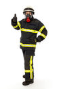 Firefighter in protective gear with mask and suit isolated on white background Stock Images