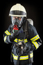 Firefighter in protective gear wearing suit helmet and mask Royalty Free Stock Images