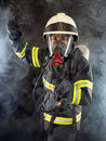 Firefighter in protective gear wearing suit helmet and mask Royalty Free Stock Photo