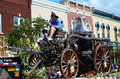 Firefighter rides old time fire engine local parade Royalty Free Stock Photography