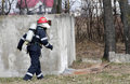 Firefighter in ruins searching for victims of damaged building Stock Photo