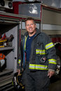 Firefighter Standing infront of fire truc Stock Photography