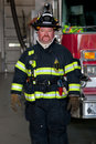 Firefighter Standing infront of fire truc Stock Image