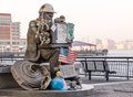 Firefighter statue at exchange place jersey city nj usa may memorial on may the was recovered from world trade center site Royalty Free Stock Image