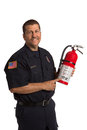 Firefighter in uniform holding fire extinguisher Stock Photos