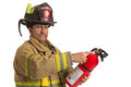 Firefighter in uniform holding fire extinguisher Royalty Free Stock Images