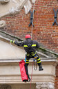 Firefighters climbing with ropes and climbing equipment on an ol Royalty Free Stock Photo