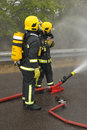 Firefighters cooling spray. Royalty Free Stock Photo