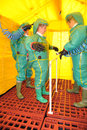 Firefighters decontamination in protective suits undergo at the scene of an incident Stock Photography