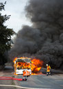 Firefighters extinguish a burning bus school in sebbenhausen community balge germany Royalty Free Stock Photography