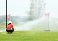 Firefighting competition firefighter woman squirting with fire hose to the target at on football stadion in rimov czech republic Stock Photography