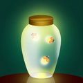Fireflies in the jar Royalty Free Stock Photo