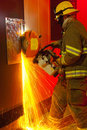 Fireman cutting through door Royalty Free Stock Photo