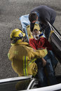 Fireman And Doctor Taking Out Victim From Car Stock Photo