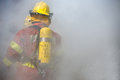 Fireman in operation surround with smoke Royalty Free Stock Photo