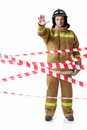 Fireman in uniform with protective tape Stock Photography