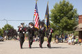 Firemen carry flags in parade fireman honor guard march with at the rathdrum days rathdrum idaho on july Stock Photos