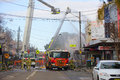 Firemen douse flames after explosion at a convenience store in r rozelle australia september firefighters on cranes the of an Royalty Free Stock Image