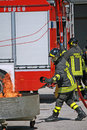Firemen extinguish a simulated fire during an exercise in their Royalty Free Stock Photo