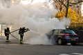 Firemen extinguishing fire from the car paris france december accident in streets of pars on december two Stock Photo