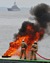 Firemen in fire, firefighting Royalty Free Stock Images