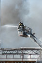 Firemen on a lift Stock Photography