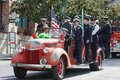 Firemen on a truck during St. Patric's Day Parade Royalty Free Stock Photos