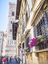 Flowers in a windows in front of Santa Maria del Fiore cathedral Royalty Free Stock Photo