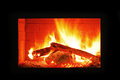 Fireplace burning in the dark Royalty Free Stock Photo