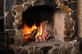 Fireplace burning firewood in the hearth Royalty Free Stock Image