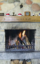 Fireplace with burning firewoods Royalty Free Stock Photography