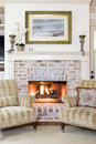 Fireplace and chairs Stock Images