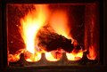 Fireplace closeup shot with burning log in Stock Image