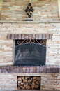 Fireplace made by small stones bricks Royalty Free Stock Photo