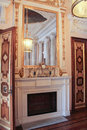 Fireplace in marble dining room.