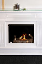 Fireplace modern built into the wall of room interior Royalty Free Stock Photography