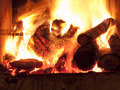 Fireplace ndoor fire place with logs on fire Royalty Free Stock Photography