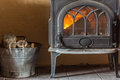 Fireplace with orange fire flame and firewood beside Royalty Free Stock Photo