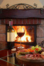 Fireplace And Red Wine 2 Royalty Free Stock Photos