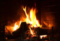 Fireplace warm flames burning in a Royalty Free Stock Photo