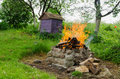 Fireplaces ease burn a pile of dry branches purple wooden bee hive Royalty Free Stock Photo