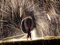 Firestarter performing fire show with sparkles in the night Royalty Free Stock Photo