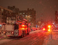 Firetrucks during snow storm a couple of fire trucks on an ottawa street a snowfall Royalty Free Stock Photography