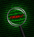 Firewall in red revealed in green computer machine code through a magnifying glass the word Royalty Free Stock Photo