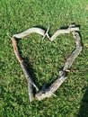 Firewood art on my lawn a heart made of wood to send love to above Stock Photos